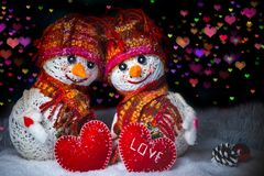 Love snowmen. Snowfall. Love concept. Greeting card Merry Christmas and happy new year. Love snowmen. Snowfall. Snow background. Love concept. Merry Christmas Royalty Free Stock Photo
