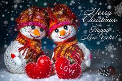 Love snowmen. Snowfall. Love concept. Greeting card Merry Christmas and happy new year. Love snowmen. Snowfall. Snow background. Love concept. Merry Christmas Royalty Free Stock Image