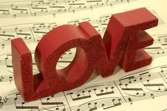 Love Song. Photo of Sheetmusic With The Word Love on Top Royalty Free Stock Image