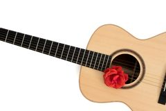 Love song. Acoustic guitar with red rose. Romantic music concept image