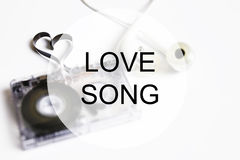Love song background om audio cassette tape shape heart Stock Photo