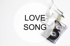 Love song background om audio cassette tape shape heart Stock Photos