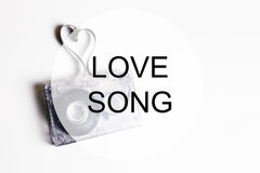 Love song background om audio cassette tape shape heart Royalty Free Stock Photography