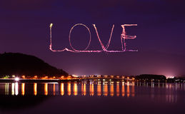 Love sparkle Fireworks celebrating over bridge of Lake Kawaguchi Stock Photos