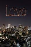 Love sparkle Fireworks celebrating over Tokyo cityscape at night Stock Photo