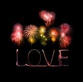 Love sparkler firework light alphabet with fireworks Royalty Free Stock Image