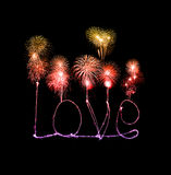 Love sparkler firework light alphabet with fireworks Royalty Free Stock Photo