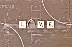 Love spelled with an engagement ring royalty free stock images