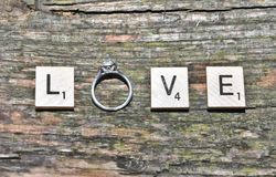 Love spelled with an engagement ring Stock Image