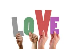 Love spelled out in a hands. Love spelled out in colour in a hands Royalty Free Stock Photo