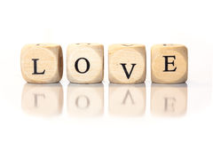 Love spelled word, dice letters with reflection Stock Photography