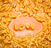 Love spelt with spaghetti letters Stock Images