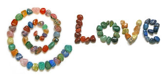 Love Spiral Healing Crystals. A Spiral and the word 'LOVE' formed from tumbled precious stones Stock Photo