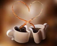 Love splash of coffee. Two heart shaped cups of coffee and love splash: heart