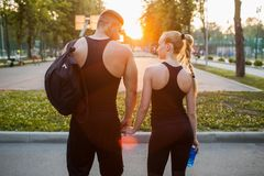 Love sportsman couple support training outdoor. Concept. togetherness and tenderness. romance of active people Stock Images