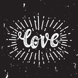Love and starburst black. Universal handwritten inscription love, in honor of Valentine s Day, vintage retro grunge design. Simple template for printing, t-shirt Stock Photo