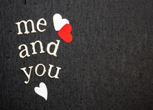 Love statement and Inspirational quote, reads me and you on Black background, White and red hearts. Text space