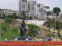 Love statue at the coastline of Chorrillos Royalty Free Stock Image