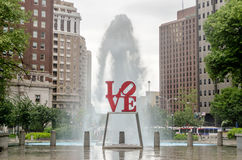 Love Statue in Philadelphia. With scenic fountain against a cloudy sky royalty free stock images