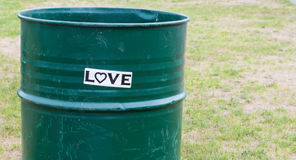 `Love` sticker on a trash barrel Royalty Free Stock Photo