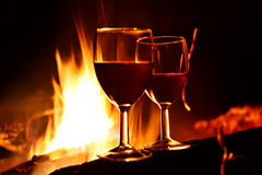 Love still-life. Night, vine glass against fire royalty free stock photos