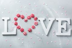 Valentines day holiday text word love with pink meringue heart Stock Image