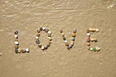 Love stones on sand beach Stock Photo