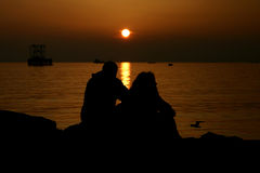 Love story. Love on beach. Love concept. Couple at golden sunset. Love under sunset. Sun, couple and love stock photography