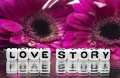 Love story. Message with pink flowers in background royalty free stock photography