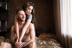 Love story in bed Stock Images