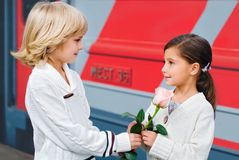 Love story. Boy gives a flower to a girl Stock Image