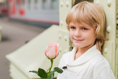 Love story. Boy with a rose waiting for a girl Stock Photos