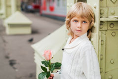 Love story. Boy with a rose waiting for a girl Stock Photography
