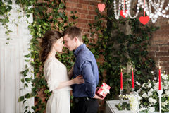Love story couple with gift box. Valentine present Stock Image
