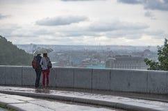 Love story couple under the rain view city pano. Rama life Royalty Free Stock Photo