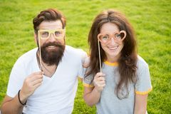 Love story. Happy together. Couple in love cheerful youth booth props. Couple relaxing green lawn. Man bearded hipster. And pretty woman in love. Summer royalty free stock photos
