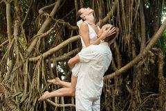 Love story in jungle Stock Images