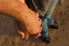 Love story. Loving each other man and woman are walking hand in hand Royalty Free Stock Images