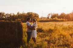 Love story man and woman on the background of haystacks  sun Stock Photo