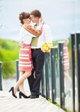 A love story. A man and a woman beautiful couple near the water Royalty Free Stock Photography
