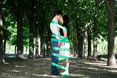 Love story in the park. Love story. Girl and boy are kissing in the garden Royalty Free Stock Images