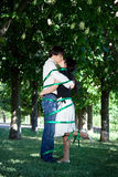 Love story in the park. Love story. They are kissing Royalty Free Stock Photo