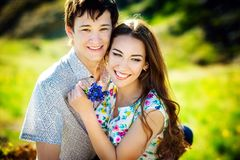 Love story of the beautiful young man and woman. embrace on a nature walk stock photography