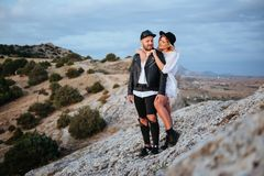 Love story on sunset. Romantic summer love story on a sunset in mountains. Young girl and boy in love Stock Photography