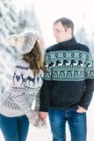 Love story in the winter forest. Young romantic couple outdoor. Valentine`s Day concept. royalty free stock photos