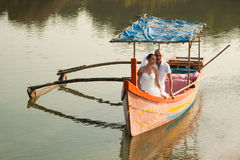 Love story in wooden boat Royalty Free Stock Image