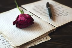 Love story writing. Blank paper sheets on old wooden table, love story Royalty Free Stock Photography