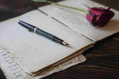 Love story writing. Blank paper sheets on old wooden table, love story writing Stock Image