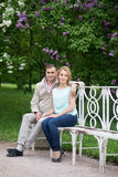 Love story, young couple on bench. Romance relationship Royalty Free Stock Image