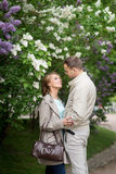 Love story, young couple in lilac garden. Romance relationship Royalty Free Stock Photo